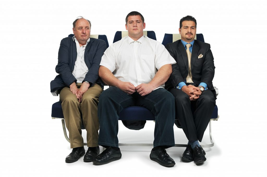 Whose Armrest Is It, Anyway? The Unspoken Etiquette Of Airline, Bus And Train Travel.